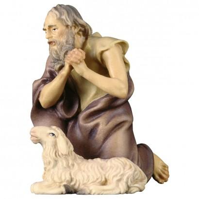 Pastore inginocchiato con pecora
