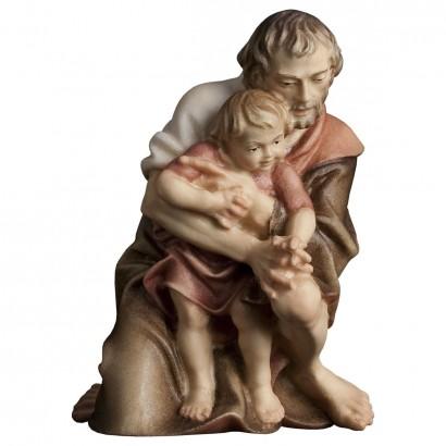 Pastore inginocchiato con bambino