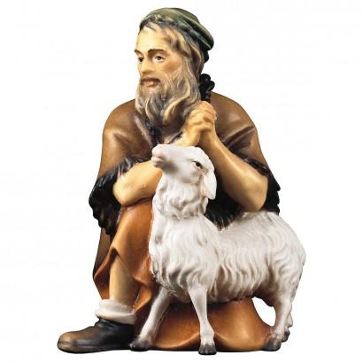 Pastore inginochiato con pecora