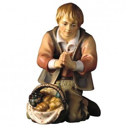 Pastore inginocchiato con pane