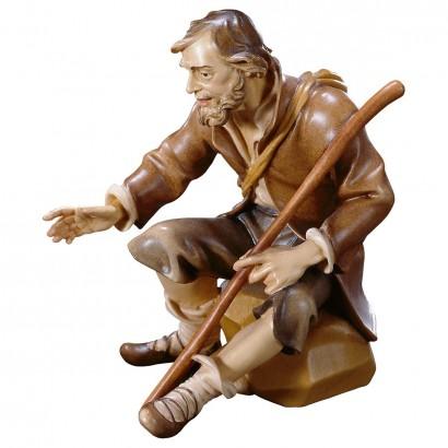 Pastore seduto con bastone