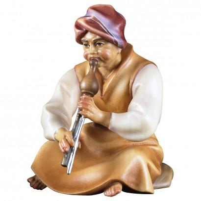 Pastore seduto con flauto