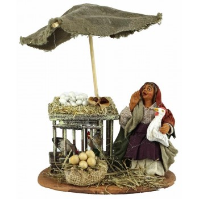 Venditrice di uova seduta in terracotta cm. 10