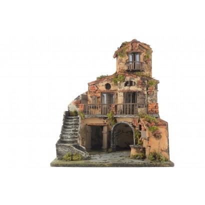 Casa con fontana e scala...